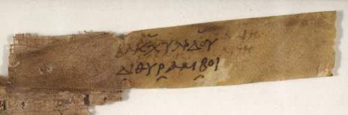 A parchment label attached to a 2nd-century papyrus fragment of Bacchylides.